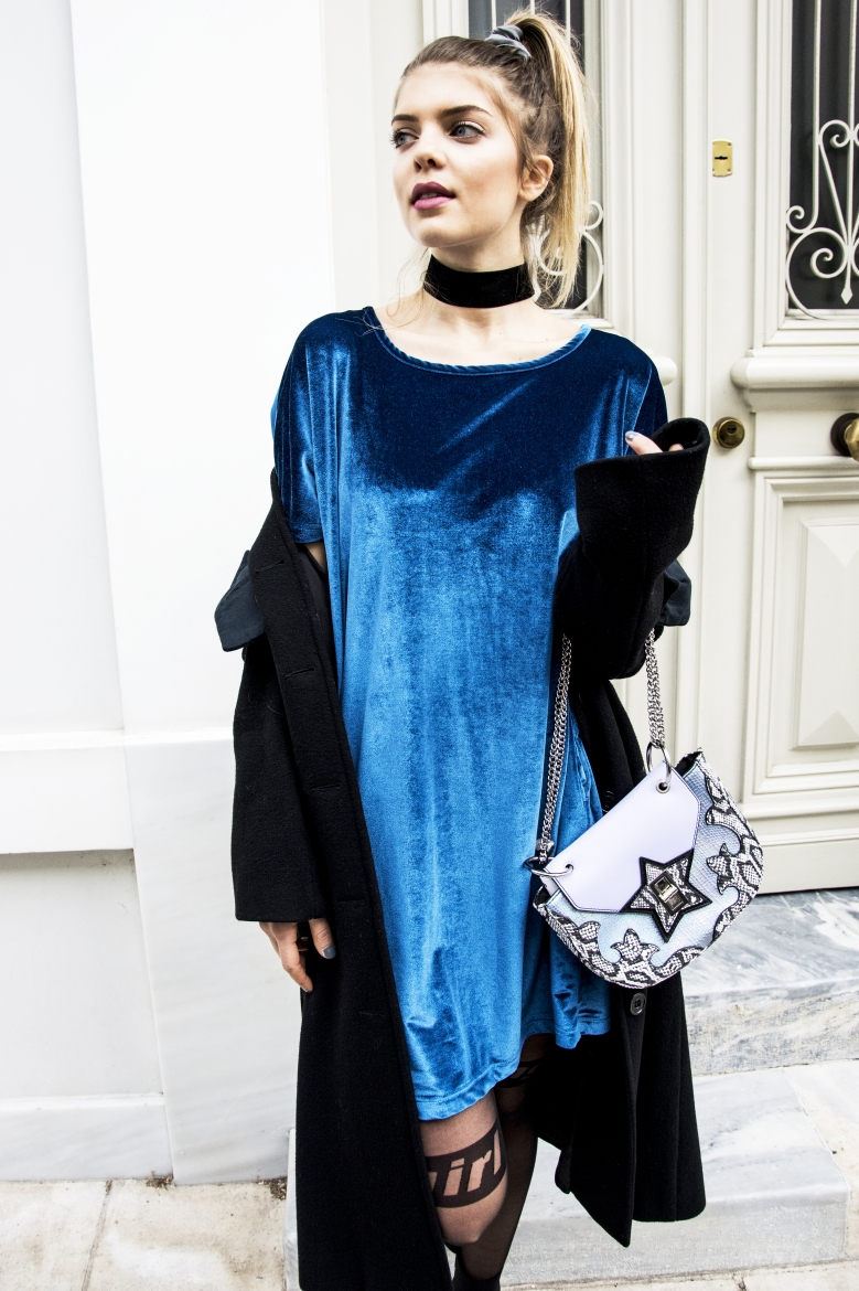 Wearing a velvet PCP dress and Skinnydip London bag